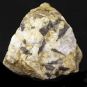 Colour image of yellow rock with black and white spots and marks