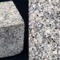 Double colour image of square gray rock block speckled with black, white and gray