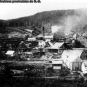 Black and white photograph of community with mine, church and employee houses