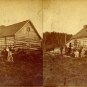 Black and white stereograph image of log house, tree stumps and people